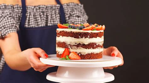 videoblocks-confectioner-girl-holds-two-hands-a-delicious